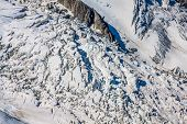 Bossons Glacier From The Summit Of The Aiguille Du Midi In The Mont Blanc Massif.