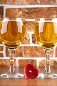 Wine bottle and glass on brick wall background