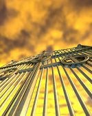 image of gates heaven  - A concept image of the golden gates to heaven shut on a dramatic golden yellow cloud background - JPG