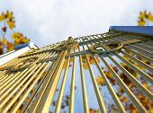 picture of gates heaven  - A concept image of the golden gates to heaven shut on an autumn leave and blue sky background - JPG