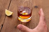 Whiskey With Ice Cubes In Glass And Grab Hand