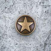 Bronze Star On Cement Background