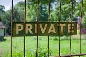 Private Sign On Rusty Gate Garden Background