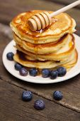 Delicious pancakes with blueberry and honey