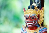 Close up of a traditional Balinese God statue in Bali temple