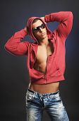 Handsome Guy Posing In A Red Hooded Shirt