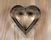 Heart Shape Cookie Molds On Wooden Surface