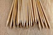 The Pile Of Toothpicks On Wooden Surface