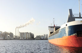 stock photo of tatas  - Tanker and power plant in Amsterdam harbor  - JPG