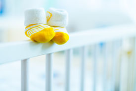 picture of bassinet  - baby booties on a cot - JPG