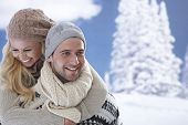 Portrait of happy loving couple embracing at wintertime outdoors.