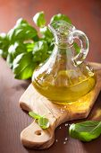fresh basil leaves herb and olive oil on wooden background