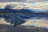 South-east Iceland in July. Icebergs and ice floes in the blue Ice lagoon Jokulsarlon