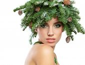 Beautiful New Year and Christmas Tree Holiday Hairstyle and Make up.