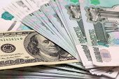 Hundred dollars and to one thousand rouble banknotes