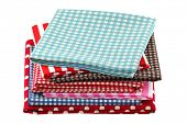 Folded fabric in different patterns, isolated on white