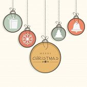 Beautiful X-mas ornaments hanging in colorful frame for Merry Christmas celebration.