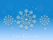 Beautiful poster or banner for Merry Christmas decorated with snowflakes on shiny blue background.
