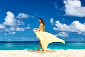 Woman with sarong at Seychelles beach