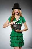 Woman wearing green dress with movie board