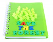 Concept of conservation forests of cut paper on notebook isolated on white