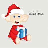 Cute cartoon of a elephant wearing Santa dress and holding gift box for Merry Christmas celebration on grey background.
