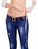 Woman Measuring Her Waist Over White