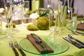 stock photo of wedding table decor  - Beautiful elegant table set for wedding or event party in green and brown with flowers indoors - JPG