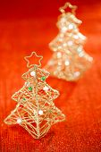 glitter christmas tree decoration on golden red background