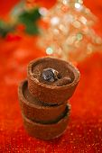 Chocolate Cherry Mini Tartlets in festive golden red style, shallow dof