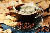 Cup of coffee and chocolate chip cookies on wooden background