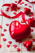 Heart shaped candles and sweet candy for Valentine's day