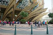 Unidentified People Walks Around The Casino Lisboa In Macau