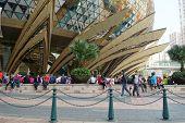 Unidentified People Walks Around The Casino Lisboa In Macau