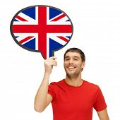 education, foreign language, english, people and communication concept - smiling young man holding text bubble of british flag