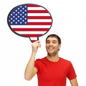education, foreign language, english, people and communication concept - smiling young man holding text bubble of american flag