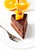 Yummy chocolate cake with orange, close-up