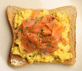 Smoked salmon and scrambled eggs on toast.