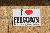 FERGUSON, MO/USA - NOVEMBER 25, 2014: Sign on boarded up window in Ferguson  in the aftermath of riots.
