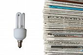 Light Bulb And New Newspapers