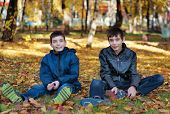 Two brothers sitting on the ground