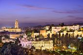 Malaga, Spain cityscape at the Cathedral, City Hall and Alcazaba Moorish fort.