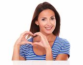 Smiling Young Lady With Heart Sign