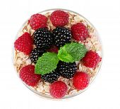 Healthy breakfast - yogurt with  fresh fruit, berries and muesli served in glass jar, isolated on white