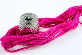 Soft Pink Cotton Thread And A Thimble
