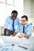 Two men talking during work