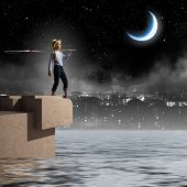 Cute girl at night with fishing rod