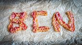 Fried Bacon Strips Put In Letters