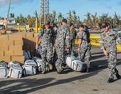 Australain Navy Sailors Unloading International Disaster Relief Supplies From A Landing Craft In The