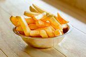 Potatoes fries on wooden board